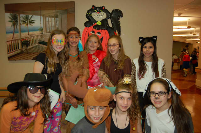 High school students posed in their Halloween costumes while visiting St. Cabrini Nursing Home in Dobbs Ferry.