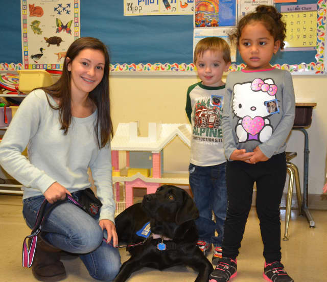 Alyssa Repetto poses with Fiesta, the guide dog she is training, at a recent visit to Lil' Sprouts Early Learning Center in Peekskill.