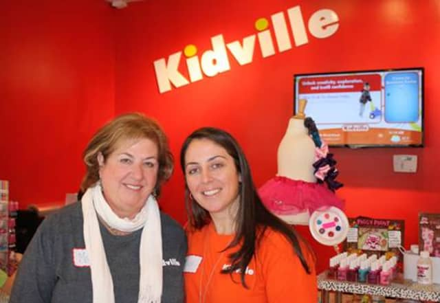 """Diana Mann (right), """"Mayor"""" of Kidville Mount Kisco with her mom Marcia Schenker (left) at Kidville's grand opening. Schenker is the early childhood development manager of Kidville Mount Kisco."""