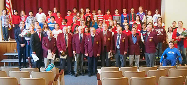 Students at Harrison's Samuel J. Preston Elementary School honored local veterans at a recent school assembly.