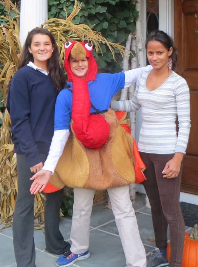 The 10th Annual Turkey Trot is Nov. 24 in New Canaan. From left are Kelly Clark, Teddy Schoenholtz and Ereide Silva