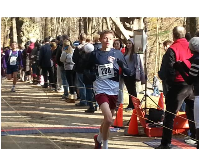 Sam Mackiewicz of The Harvey School hits the finish line at Saturday's race.