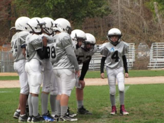 Brody McGuinn led the White Plains Tigers to a 35-6 bowl victory over Shrub Oak on Sunday.