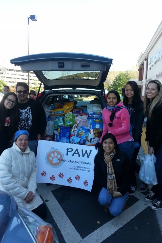 Members of the Sleepy Hollow High School Promoting Animal Welfare club collect donations for Pets Alive Westchester at a recent event.