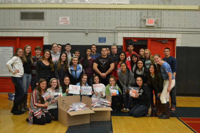 Eastchester student athletes recently shipped out supplies and letters to soldiers overseas as a part of the school's new program known as The Eagle Impact.
