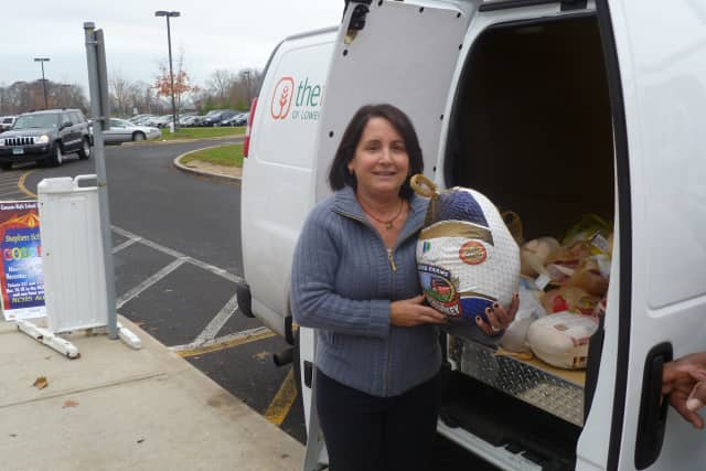 Members of the Food Bank Volunteers Club at New Canaan High School will collect Thanksgiving turkeys for the Lower Fairfield County Food Bank at the school on Tuesday and Wednesday morning.