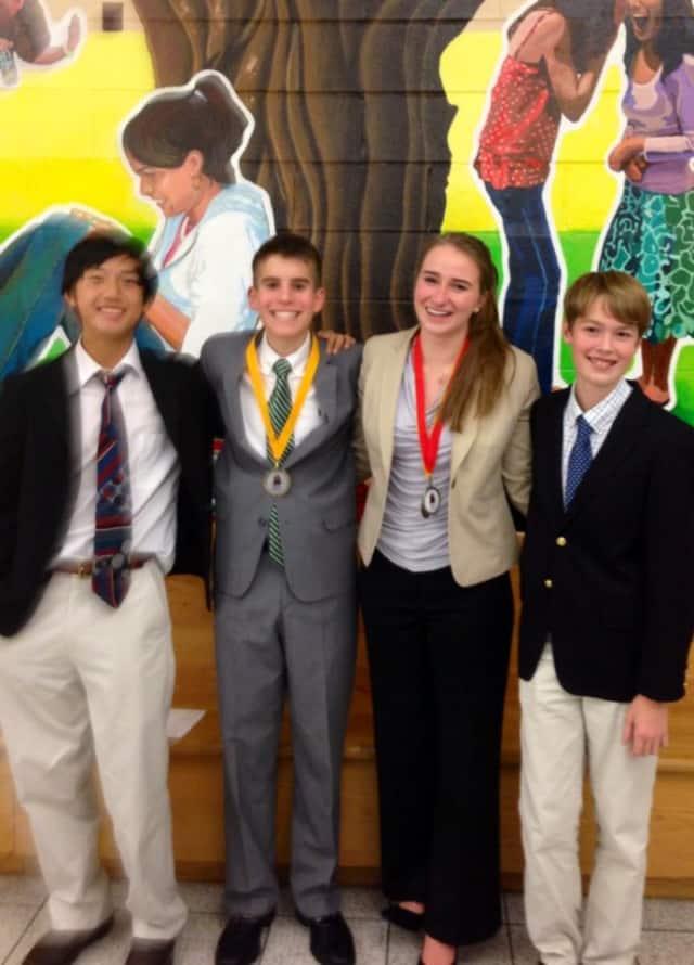 Brandon Zhang, Ryan Cross, Rachael Jones and Ryan Carlson are among members of the Wilton High School debate team.