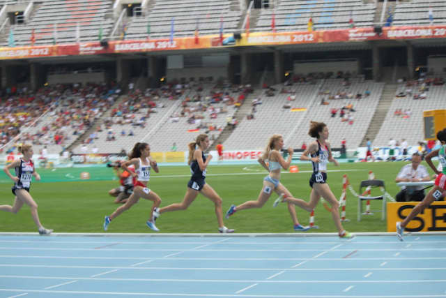 Bronxville's Mary Cain, center, seen here competing in the IAAF World Championships in Moscow, is featured in Running World Magazine.