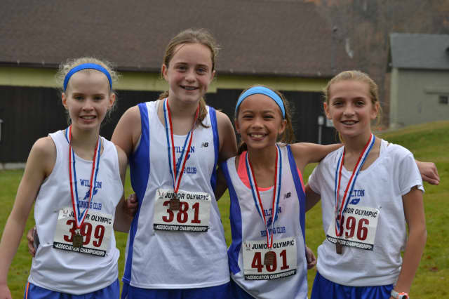 Wilton Running Club teammates (left to right) Angela Saidman,  Cora Creighton, Emily Welch and Tess Pisanelli finished in the top 10 in their division in Sunday's race.