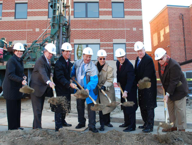 Hospital officials participate in a ceremonial ground breaking at Phelps Memorial Hospital Center recently.