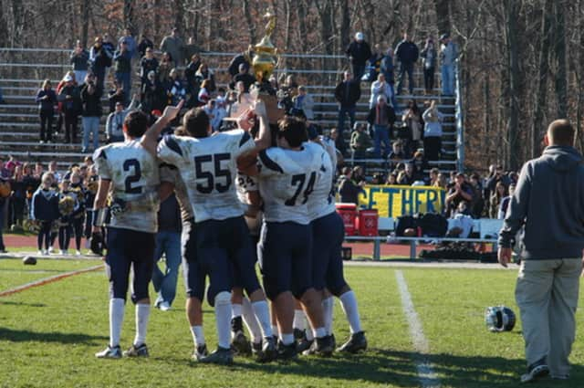 The Weston High School football team, celebrating in 2012, helped the school win the Michael's Achievement Cup from the CIAC.