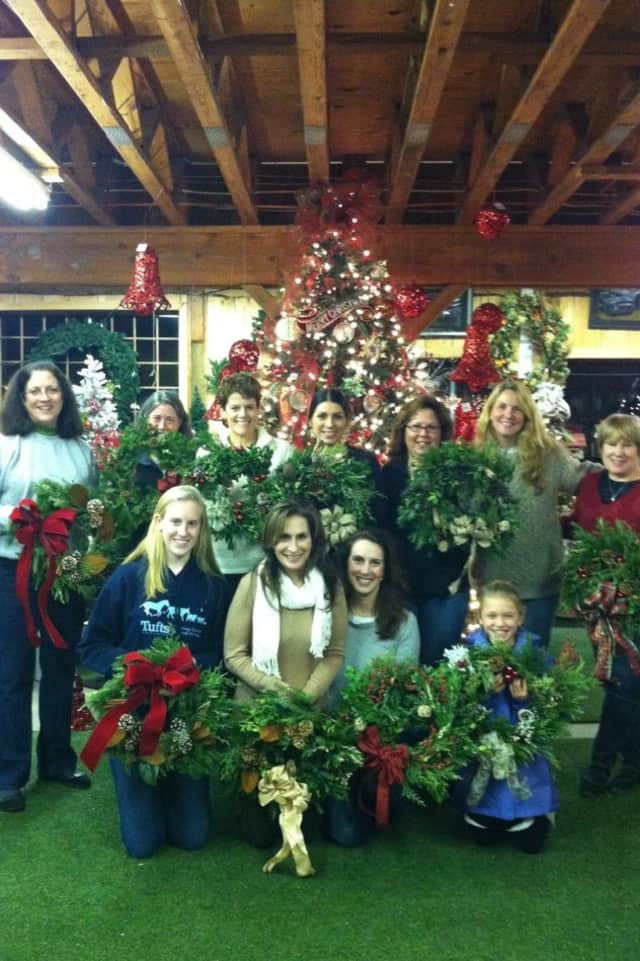 Families posing with their wreaths at 2014 event.