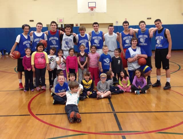 "The Hen Hud varsity boys basketball team he entire basketball team with many of the students they worked with at Buchanan-Verplanck Elementary School's ""Sports Club."""