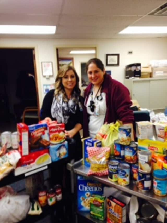 NWH Employee Congress Co-Chairs Lauren DeSha, Medical Records and Kim Mulroy, RN with just SOME of the food collected from staff and visitors for the Mount Kisco Food Pantry Thanksgiving Food Drive.