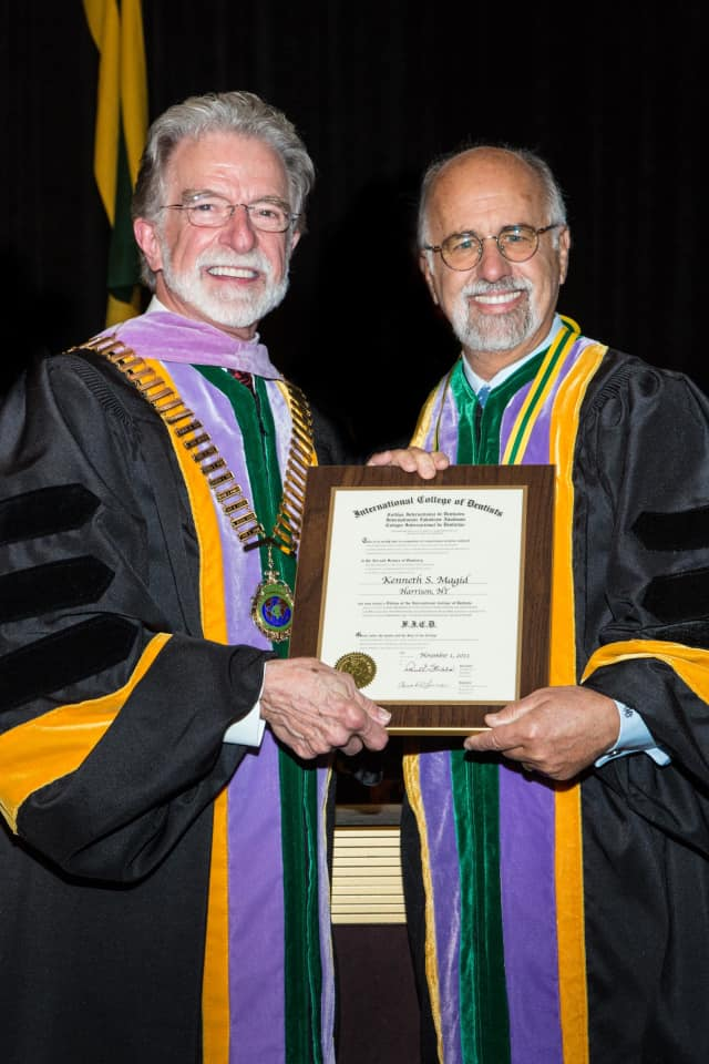 Harrison's Dr. Kenneth Magid, right, was recently inducted into the International College of Dentists.