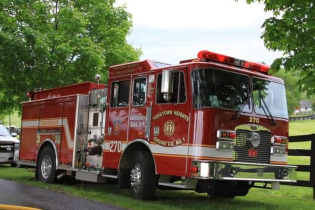 A Yorktown man set his house on fire Monday afternoon while his elderly mother still was inside, police said.