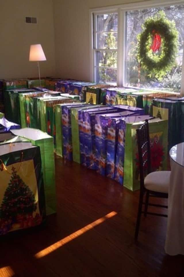 Harrison's Holiday Project raised more than $20,000 for needy families in the area. Each family receives a basket with gifts, food and gift cards.