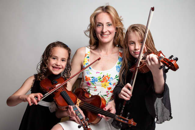 Scarsdale Strings founder Anna Stampfli, with two of her pupils.