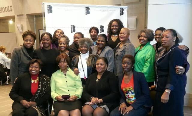 The Westchester Black Women's Political Caucus, Inc.-Yonkers chapter welcome families to a recent health-care forum.
