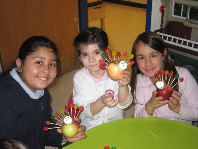 The Chapel School fourth-grade students enjoy their Thanksgiving feast in Bronxville.