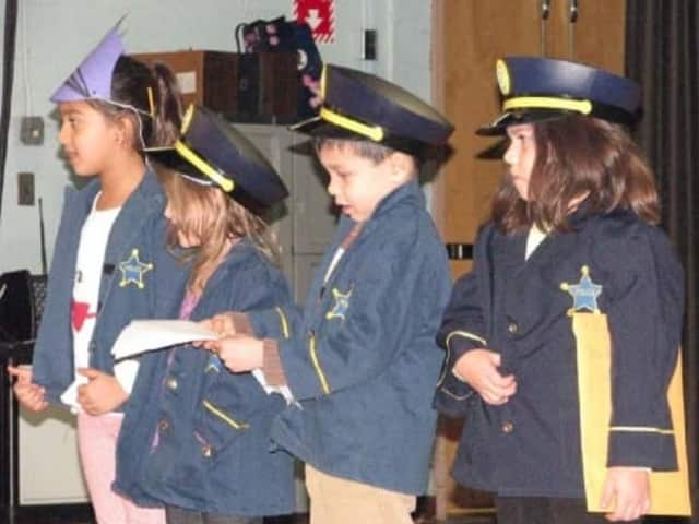 Osborn students pay tribute to the Rye Police Department during a recent assembly.