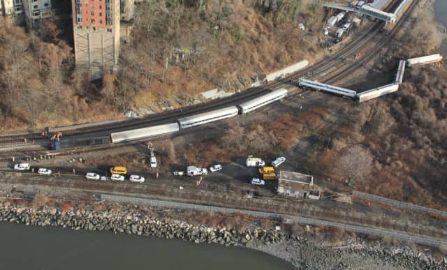 The Metro-North train engineer who fell asleep at the wheel, causing a derailment that killed four and injured 60 in the Bronx two years ago, was awarded a federal pension on Thursday.
