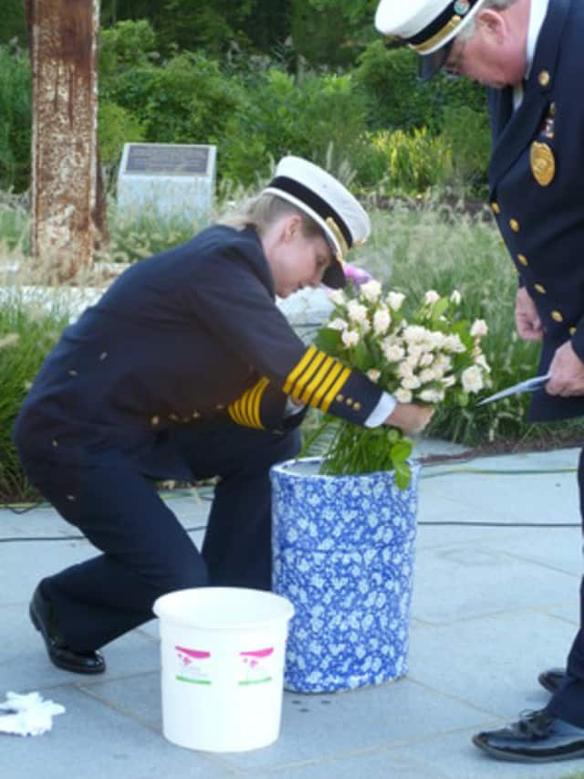 Ridgefield Fire Chief Heather Burford pictured here placing flowers during a 9-11 memorial, will be leaving Ridgefield for a new position in Florida.