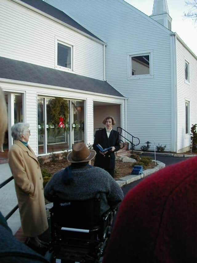Rev. Nadine Hundetrmark dedicates ADA compliant entrance to the white church in South Salem in December 1999.