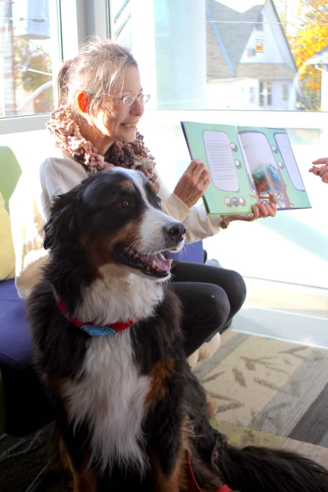 "The Mamaroneck Library Board of Trustees helps the library organize programs, such as a therapy dog reading program called ""Paws A While To Read."""
