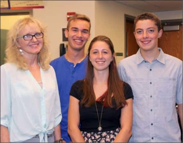Pleasantville High School choral teacher Kathleen Donovan-Warren with Nickolas Andreacchi, Liana Frasco and Justin Maldanado.