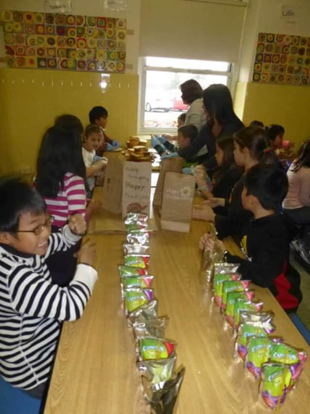 Fourth-graders at Eastchester's Anne Hutchinson School helped make lunches for Hope Community Services in New Rochelle.