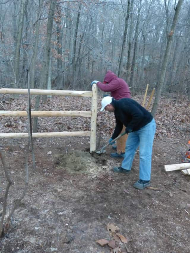 Members of the Yorktown Dog Park Committee construct a fence for the off-leash dog park at Sylvan Glen Park Preserve in Yorktown.