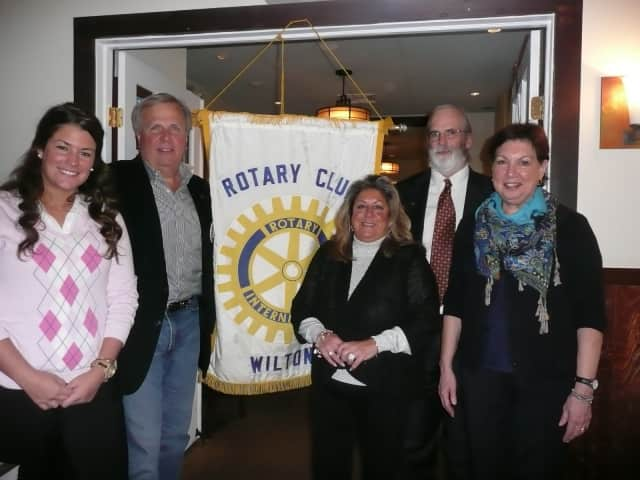 Pictured (from left) are Janeen Leppert, Rotarian Pat Russo who performed the induction, Rotarian Carol Johnson who sponsored both new members, Rotary President Paul Burnham, and Elizabeth Edwards.