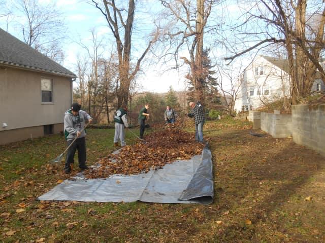 Pleasantville High School's varsity football team cleaned seniors' lawns.