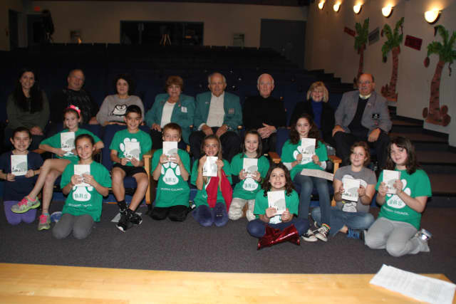 Bedford Road third graders enjoy dictionaries given to them by members of the Elks club.