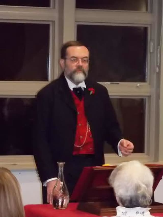 "Larchmont Librarian Frank Connelly donned his frock coat and top hat to continue his annual tradition of reading ""A Christmas Carol"" on Monday, Dec. 9."