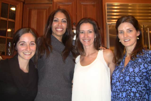 Left to right, Lena Nurenberg, Nikki McMann, Krista Kassis and Siobhan MacDonald enjoy the recent Pound Ridge Neighbors & Newcomers holiday party.