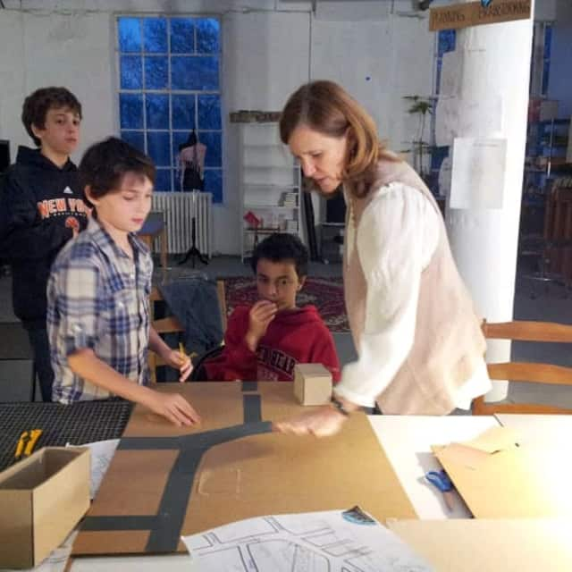 Kids are shown at work redesigning Dobbs Ferry's Gateway at Curious-on-Hudson.