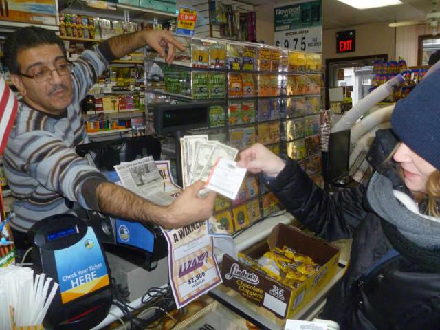 Jennifer Abel grabbed a $1 Mega Millions ticket at Mababa Deli in Hastings on Tuesday.