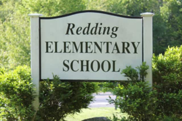 An office assistant at Redding Elementary School will be cut as part of the 2016-17 budget.