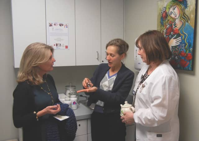 Cindi Bigelow, president and CEO of Bigelow Tea, visits naturopathic physician Dr. Veronica Waks and patient care coordinate Pat Poniros at the Norma F. Pfriem Breast Care Center.