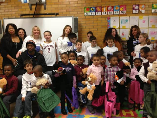 Members with Armonk's Heavenly Productions Foundation brought supplies to Far Rockaway schools affected by Hurricane Sandy.