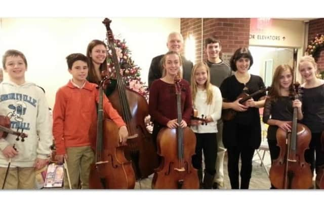 Lawrence Hospital Center President and CEO Edward M. Dinan greets members of the Bronxville Middle School orchestra and its director,  Claire Stancarone.