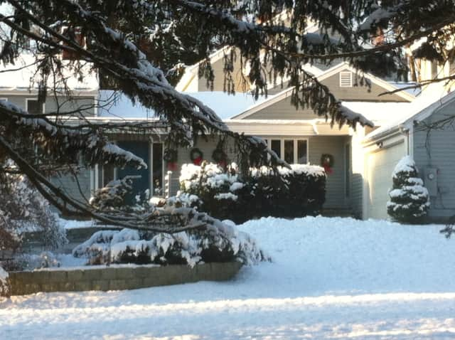 A home on Warncke Road in Wilton is decorated with several wreaths for the Christmas season.