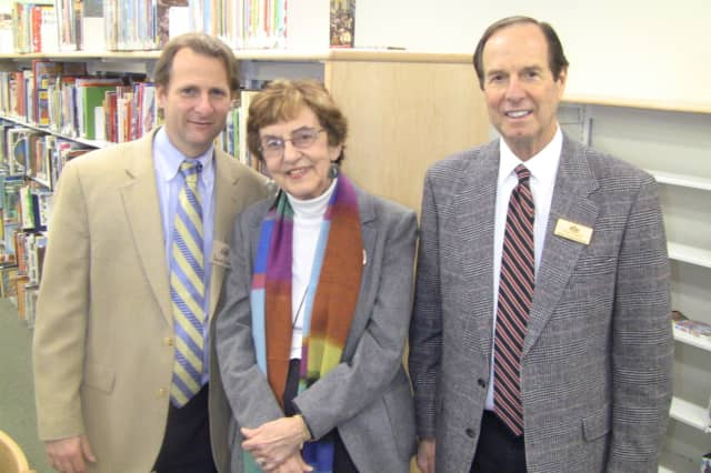 Attending the re-opening of the Pound Ridge Library Children's Room is David Dow, President of the Library Board, Marilyn Tinter, Library Directory and Jon Posner, President of the Pound Ridge Library Foundation.