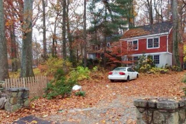 The home at 77 Range Road in Wilton was the site of a vicious dog attack in which the homeowner lost one of her arms and part of the other.