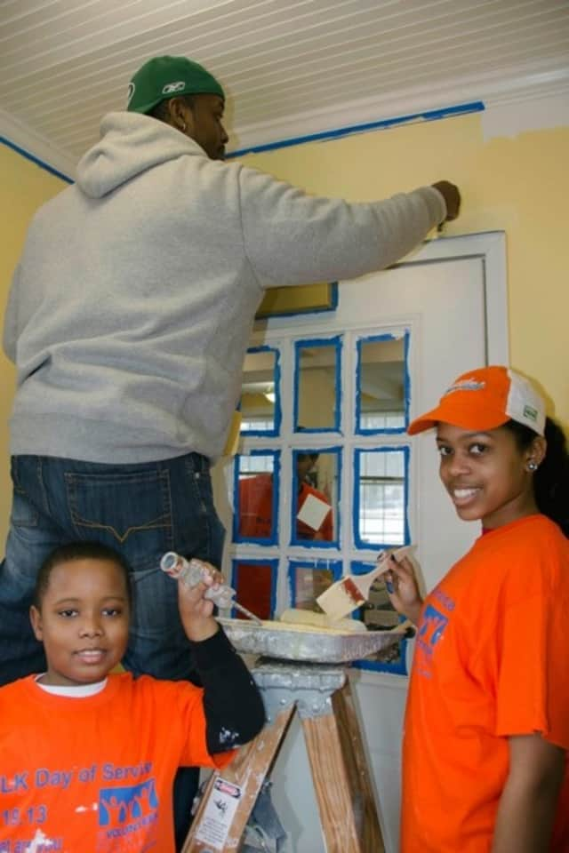 Volunteers paint at the Huguenot Children's Library, a branch of the New Rochelle Public Library, at last year's MLK Day of Service.