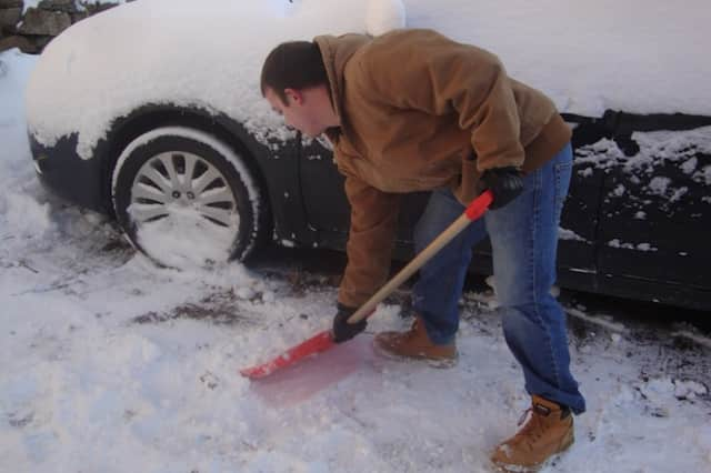Use care when shoveling snow following a storm.