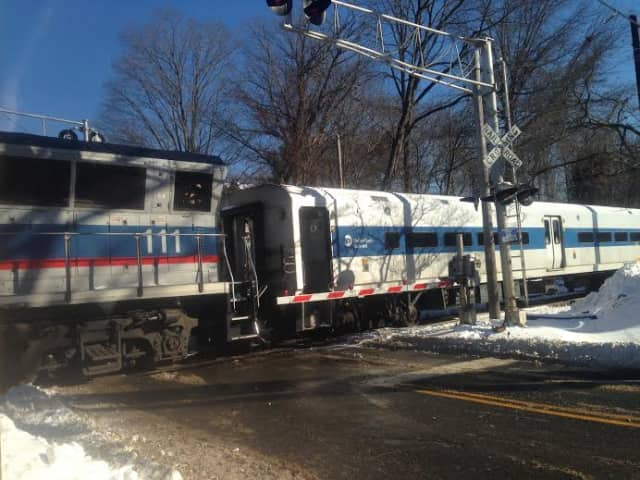 A Metro-North train sits at the crossing at Shelter Rock Road on Saturday afternoon after striking a car.
