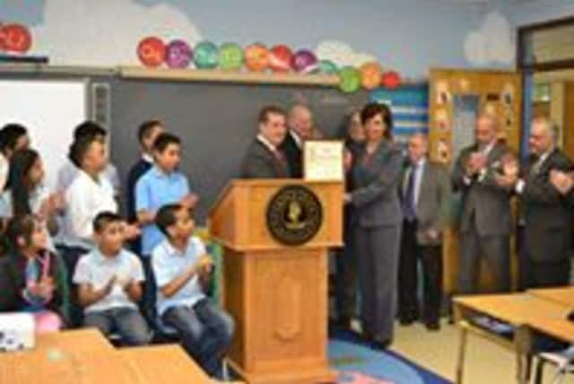 Mayor Spano honors the Robert C. Dodson School.